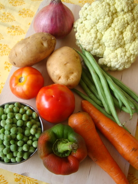 Vegetables - carrots, capsicum, beans, potato, cauliflower, peas, onions, tomatoes