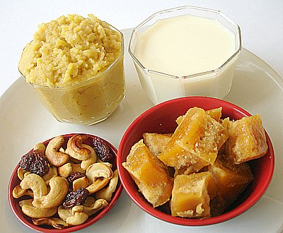 Cooked moong dal, milk, jaggery, fried cashewnuts and kismis